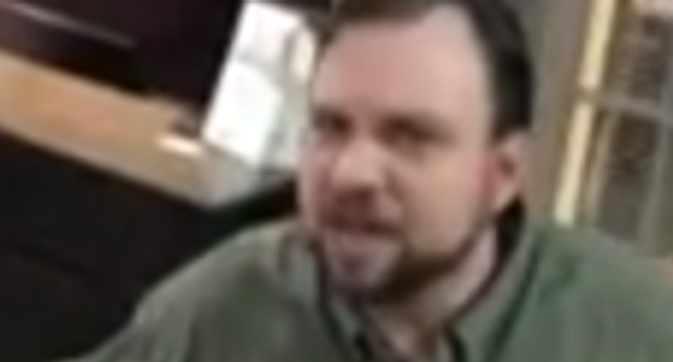WATCH: Racist hotel clerk calls black man a 'f*cking monkey' after he asks for a refund