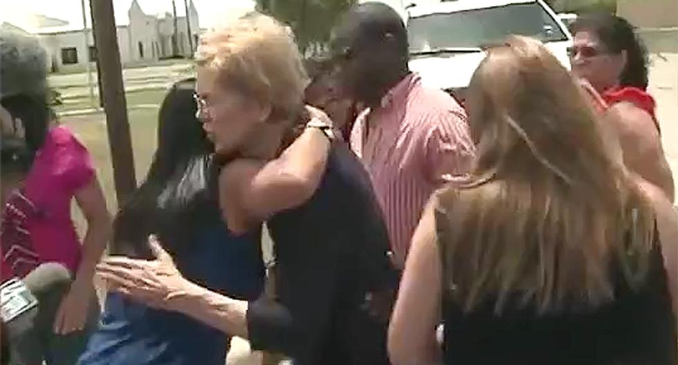 WATCH: Elizabeth Warren fights back tears describing what she saw at Trump's detention center in Texas