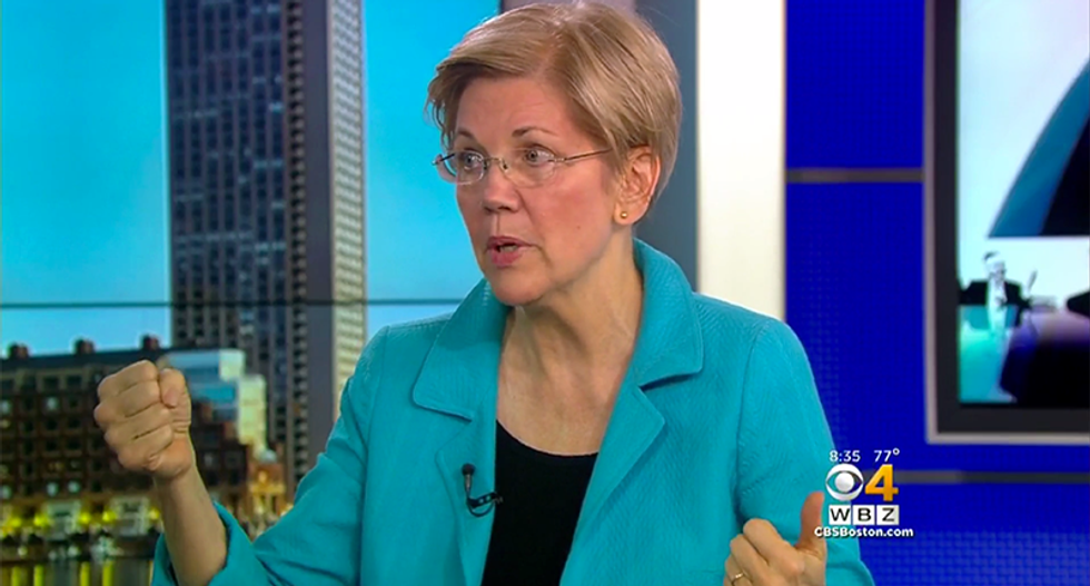 Elizabeth Warren vows to always 'punch back' against 'thin-skinned, racist bully' Donald Trump