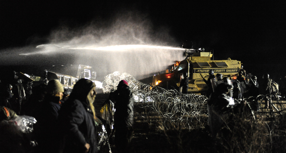 WATCH: Police hit #NoDAPL protesters with water cannons in sub-freezing weather