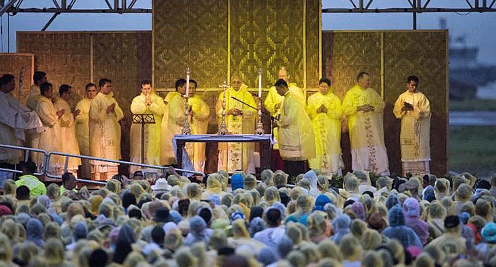 Pope flees Philippine storm, cuts short typhoon mercy trip