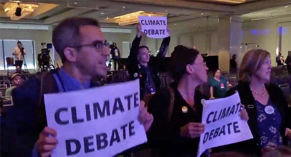 WATCH: Climate activists chant 'failure of leadership' at Tom Perez after DNC votes against climate debate