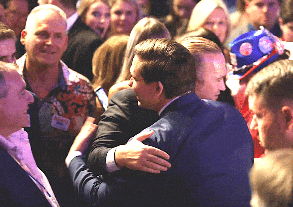 Images show FL Governor Ron DeSantis hugging Rudy Giuliani's henchmen after claiming he didn't know them