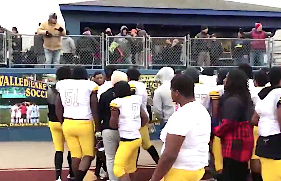 Black students spit upon and pelted with garbage by parents after taking a knee at high school football game