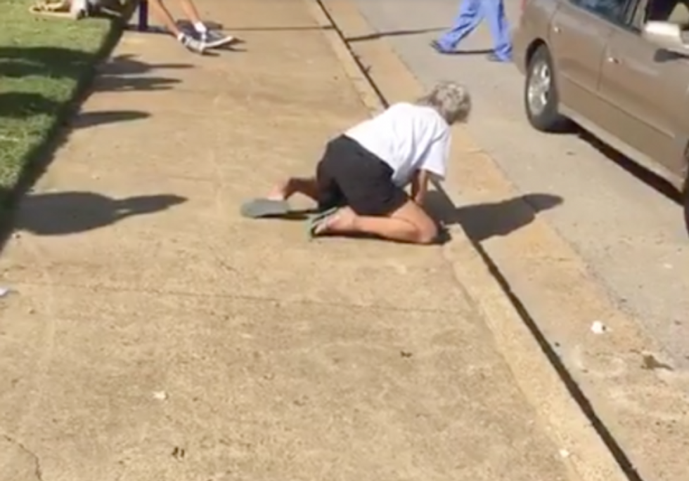 An overdosing Memphis couple passed out on the street (Facebook)