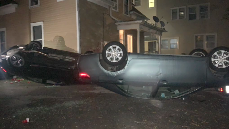 WATCH: Protesters storm frat house over rape allegations -- flipping over cars and breaking down the door