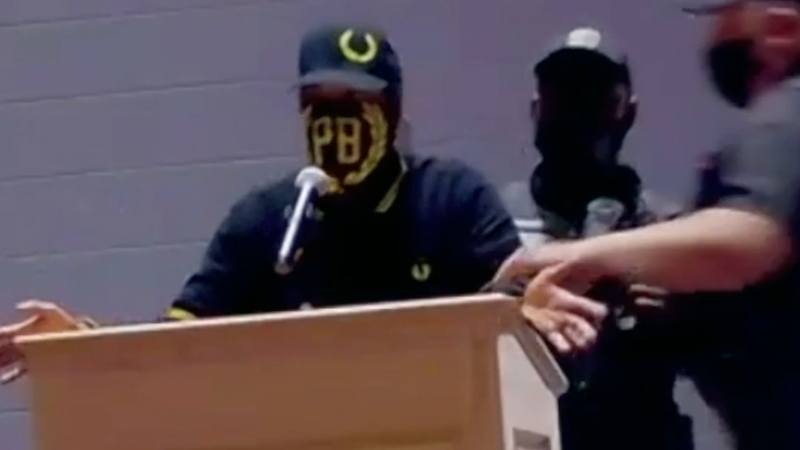 WATCH: Proud Boys escorted out of meeting as school board OKs resolution condemning racism