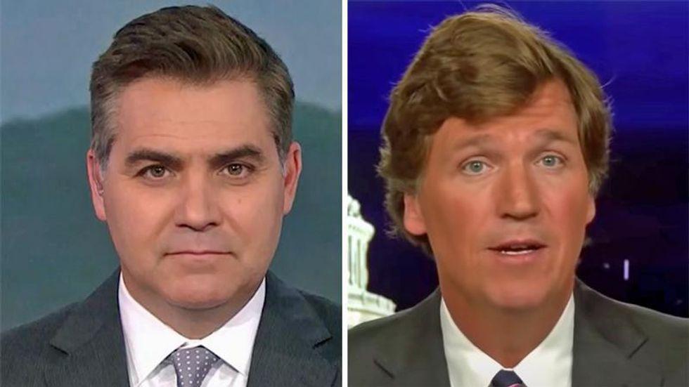 Tucker Carlson wins profane award from CNN's Jim Acosta