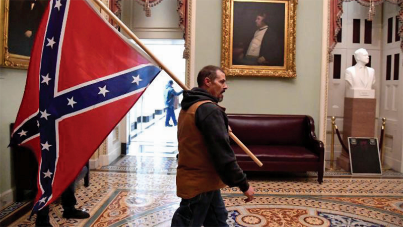 Confederate flag carrying Capitol insurrectionist hit with more federal charges