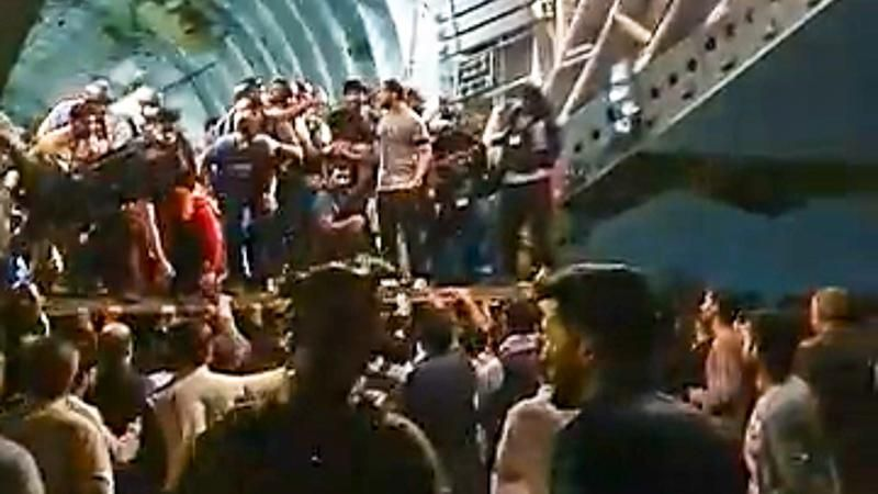 WATCH: Chaos at Kabul airport as hundreds try to board C-17 cargo plane to flee Afghanistan