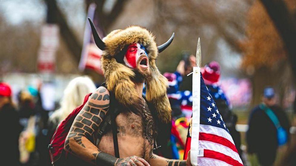 QAnon shaman's plea hearing interrupted by 'wild yells' of 'freedom!'