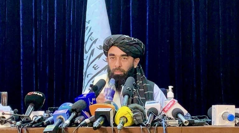 Taliban say Afghan women will be allowed to work and study 'according to Islamic law'