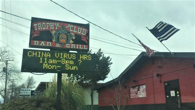 Owner hurled racist abuse at man after he complained about bar's 'China virus' sign: report