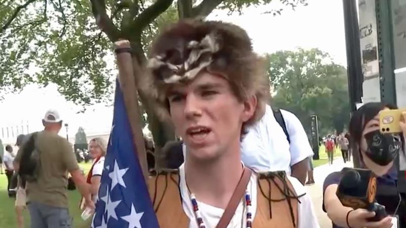 Trump supporter wearing dead animal refuses to believe Jan 6 was violent — even after CNN showed him video
