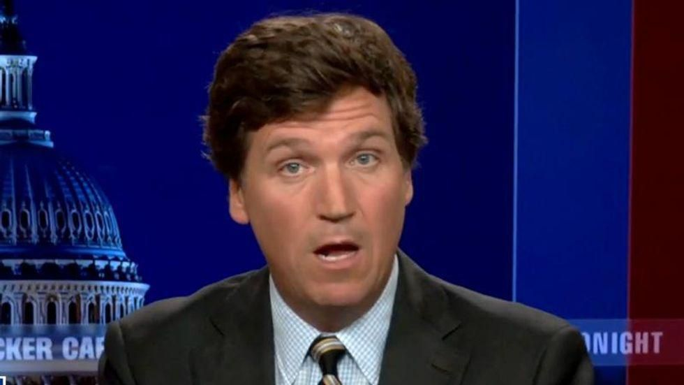 Why Tucker Carlson really went to Hungary